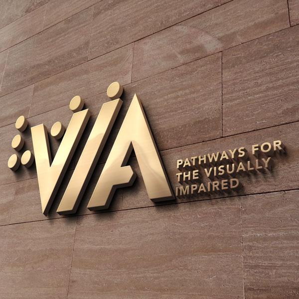 VIA, Pathways for the visually impaired. Wall-mounted logo and tagline in gold.