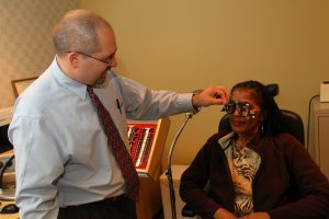 Dr. James Simmons at VIA WNY examining a patient | Low Vision Clinic