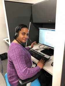 Sharell B., a Statler Center graduate, working at the 211WNY Call Center.