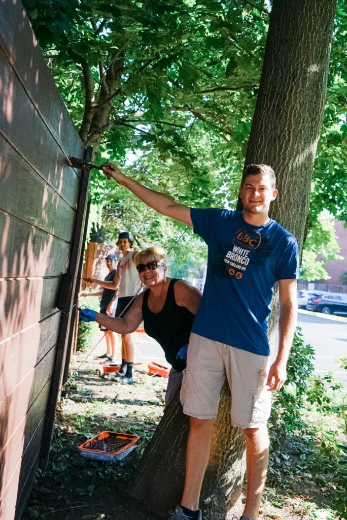 Bonadio staff painting VIA's fence.