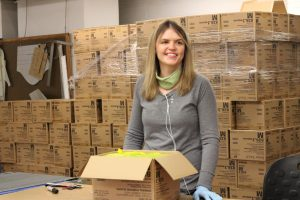VIA staff is packing gloves for Wegmans' distribution.