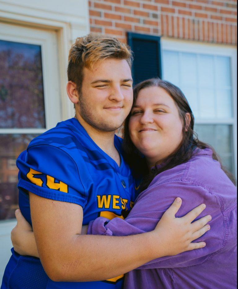 VIA clients Trisha and Zach hugging.